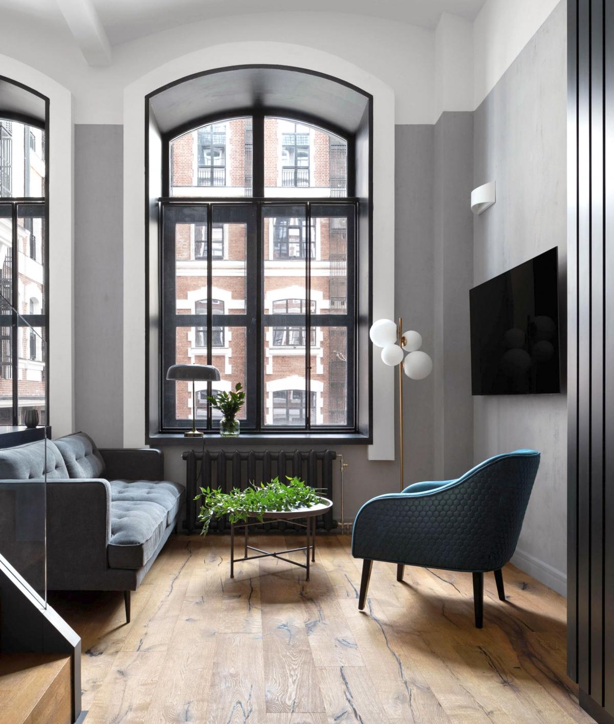 Брутальный интерьер небольшой гостиной